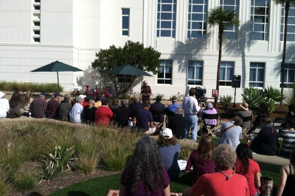 SMRR Co-Chair and longtime friend of Ken Genser speaks at the dedication of Ken Genser Square.
